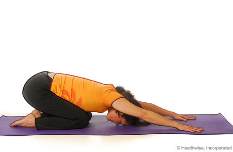 Picture of a woman in step three of yoga extended puppy pose